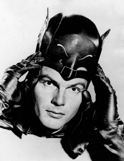 adam-west-lifts-cowl-getty